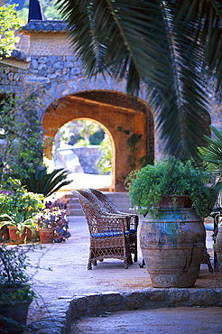 Basket-chair and plants at the courtyard of Finca Hotel de Reis, Valle de los Naranjos, Soller, Majorca, Spain, Europe