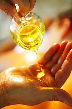 Pouring oil in hands