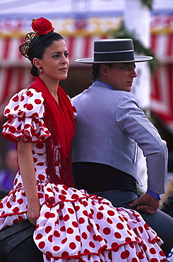 Middle-aged couple in traditional costumes on horseback, Romeria de San Isidro, Nerja, Costa del Sol, Malaga province, Andalusia, Spain, Europe