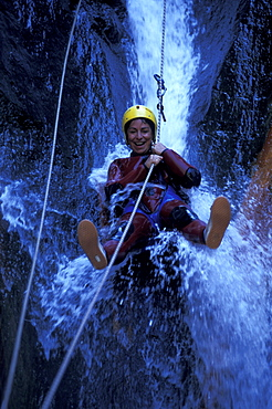 Person canyoning at the Gobert Waterfall, Cilaos, La Réunion, Indian Ocean