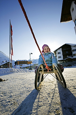 Little girl on sledge, Kuehtai, Tyrol, Austria