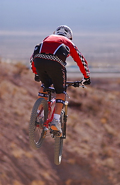 Man on a mountain bike doing a jump, Gooseberry Trail, Zion National Park, Springdale, Utah, USA