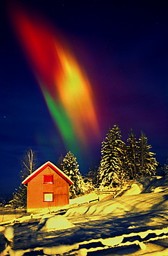 Colourful lights above snow covered house, Oslo, Norway, Scandinavia, Europe