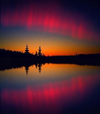 Northern lights reflecting on a lake, Lappland, Norway, Scandinavia, Europe