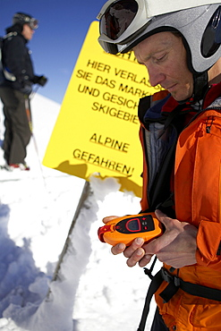 Skiing guide checking snow, Bavaria, Germany