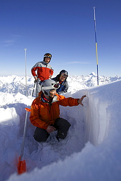 Mountain guide checking snow, danger of avalanches, Oberstdorf, Bavaria, Germany