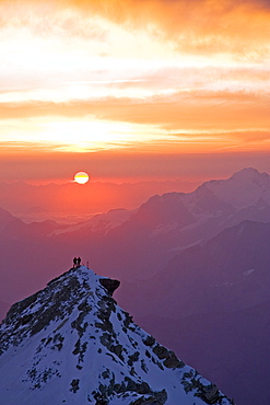 Two climbers on top of second summit of Bishorn at sunrise, Bishorn, 4135 meters, Valais, Wallis, Switzerland, Alps