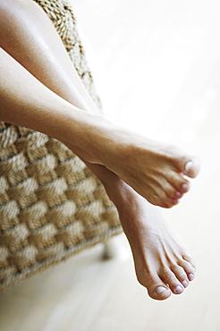 Legs of sitting woman