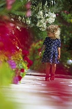 Little girl walking on trail