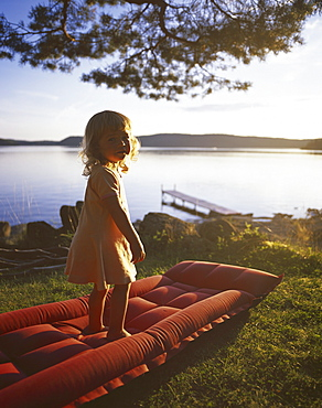 Little girl standing on air bed