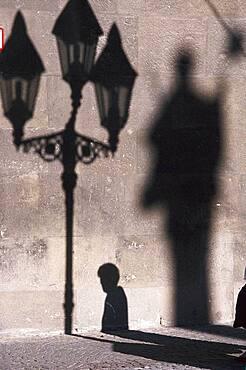 Shadow play on a wall, Wuerzburg, Bavaria, Germany