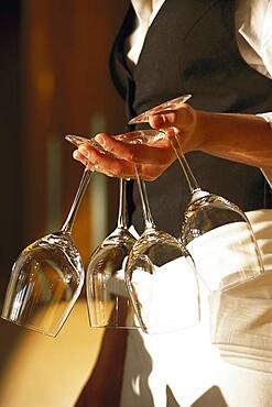 Waitress with wineglasses, Restaurant