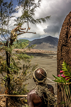 Locals on ash field in front of the Yasur volcano on Tanna, Vanuatu, South Pacific, Oceania
