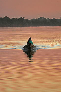 Gambia; Central River Region; Afterglow on the Gambia River near Kuntaur; two men in a boat