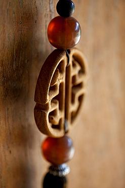 Detail shot of a Chinese, decorative key chain. Bali, Indonesia.