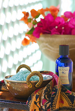 Detail shot Spa treatment products, salts, oils and flowers. St. Lucia, West Indies.