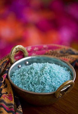 Detail shot of a bowl blue salt for spa treatments. St. Lucia, West Indies.