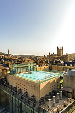 View of exterior roof-top pool set against the scenery of old turrets and buildings. Vertikal. Bath. United Kingdom