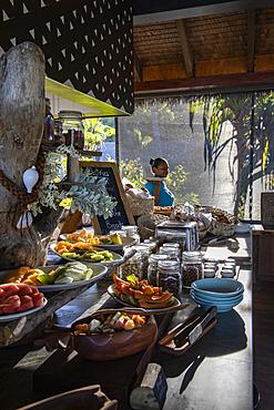 Waitress behind a fantastic breakfast buffet in the Tovolea Restaurant of the Six Senses Fiji Resort, Malolo Island, Mamanuca Group, Fiji Islands, South Pacific