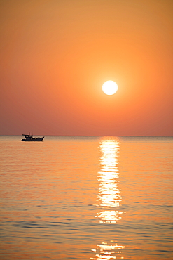Silhouette of fishing boat at sunset, Ong Lang, Phu Quoc Island, Kien Giang, Vietnam, Asia