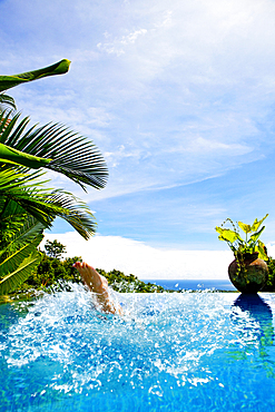 Woman´s feet as she splashes into a pool. Bali, Indonesia