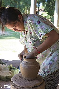Woman makes ceramic vase in a pottery village, Andong Russei, Kampong Chhnang, Cambodia, Asia
