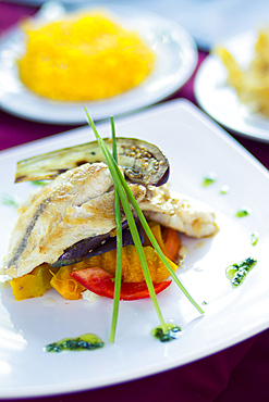 Fish and some vegetables on a plate in Havana, Cuba