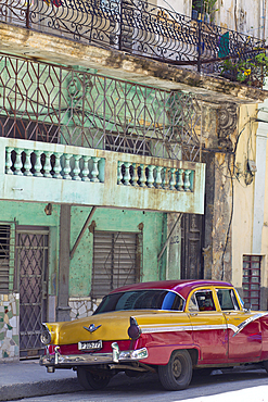 Red and yellow classic car in Havana, Cuba