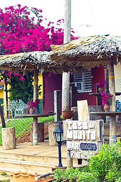 Terrace and wooden sign board of Casa del Mojito Bar in Viñales, Cuba
