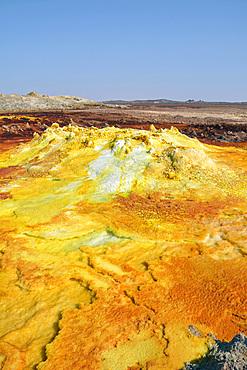 Ethiopia; Afar region; Danakil Desert; Danakil Depression; Dallol geothermal area; hot sulfur springs; cone-like formation in intense yellow, red and green tones
