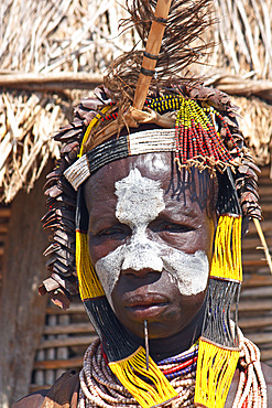 Ethiopia; Southern Nations Region; southern Ethiopian highlands; Kolcho village on the Omo River; Karo woman with headdress and face-paint;