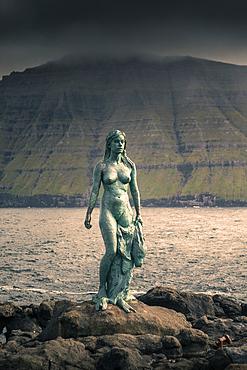 Statue of Kópakonan, mermaid in the village of Mikladalur on the island of Kalsoy, Faroe Islands