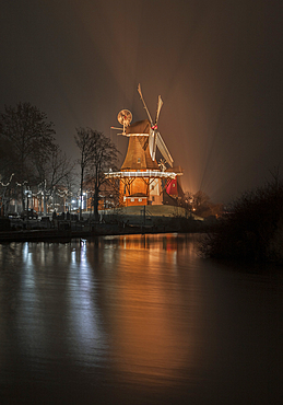 View of the old windmill in Greetsiel, Germany