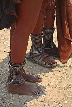 Angola; in the southern part of Namibe Province; Muhimba women's foot jewelry; wide silver rings around the ankles