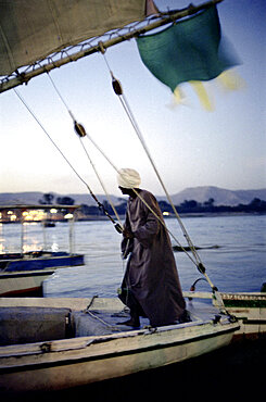 man on a sailing boot, luxor, aswan, egypt