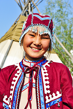 Young people in traditional costumes for tourist presentations. Shigansk is a settlement on the lower reaches of the Lena, where it crosses the Arctic Circle on its way to the Arctic Ocean. It was founded in 1632. The population lives mainly from fur hunt