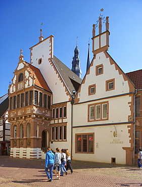 Corner Mittelstrasse, Markt (market place) with pharmacy and spires of St Nicolai church in the town of Lemgo, Strasse der Weserrenaissance, Lippe, North Rhine-Westphalia, Germany, Europe