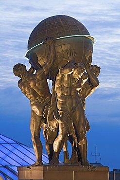 Atlas figures on roof of Museum for Communication at night, Berlin