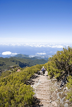Hikers descend from Summit of Pico Ruivo Mountain, Pico Ruivo, Madeira, Portugal