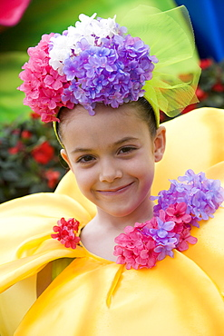 Girl with flower costume during the parade at the Madeira Flower Festival, Funchal, Madeira, Portugal