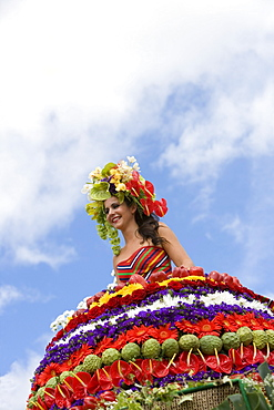 Woman on Floral Float at Flower Festival Parade, Funchal, Madeira, Portugal