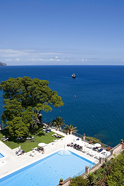 Swimming Pool in Reid's Palace Hotel with the Santa maria tourist boat in the background, Funchal, Madeira, Portugal
