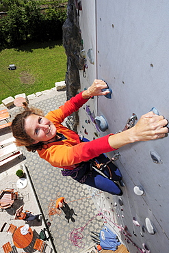 Woman climbing, Rosenheim, Upper Bavaria, Bavaria, Germany
