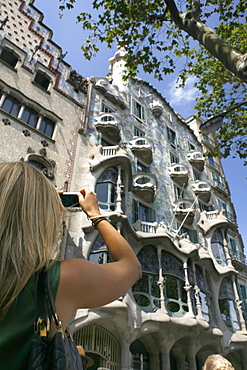 Tourist shot Gaudi's Casa Batllo, Passeig de Gracia, Barcelona, Catalonia, Spain