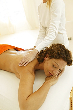 Young woman receiving ayurveda treatment, Wellness