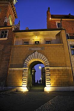Illuminated gate to Wawel cathedral, Krakow, Poland, Europe