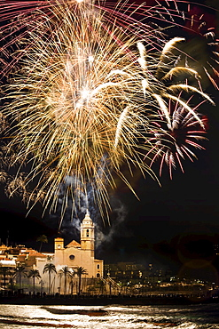 Firework display over Sitges Cathedral La Punta at night, Festival of Santa Tecla, Sitges, Catalonia, Spain, Europe