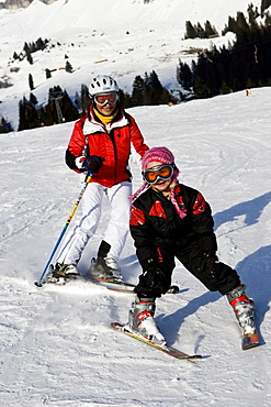 A little girl and her grandmother skiing at Flims, Graubuenden, Switzerland