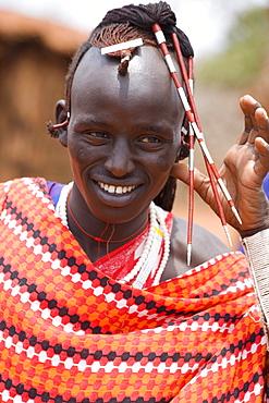 Portrait of a young Massai man with headdress, Tsavo, Kenya, Africa