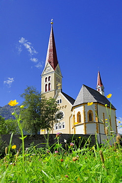 sea of flowers with church in Holzgau, valley Lechtal, Tyrol, Austria